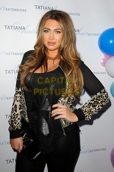 Lauren Goodger<br /> The Tatiana Hair Extensions LFW Avant Garde Catwalk Collection, Tatiana Hair Extensions, Kensington, London, England. <br /> 11th September 2013<br /> fashion week half length black leopard print jacket hand on hip<br /> CAP/MAR<br /> &copy; Martin Harris/Capital Pictures