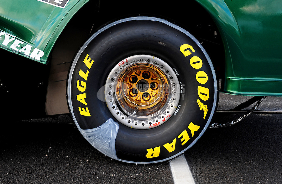 Jan 23, 2010; Chandler, AZ, USA; Detailed view of the Goodyear drag racing tire on the car of NHRA funny car driver John Force (not pictured) during testing at the National Time Trials at Firebird International Raceway. Mandatory Credit: Mark J. Rebilas-