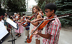 The Carson City Symphony's Strings in the Schools summer fiddle orchestra performs at Sierra Place in Carson City, Nev., on Tuesday, July 23, 2013. <br /> Photo by Cathleen Allison