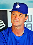 22 July 2011: Los Angeles Dodgers Manager Don Mattingly sits in the dugout prior to a game against the Washington Nationals at Dodger Stadium in Los Angeles, California. The Nationals defeated the Dodgers 7-2 in their first meeting of the 2011 season. Mandatory Credit: Ed Wolfstein Photo
