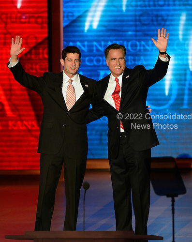 United States Representative Paul Ryan (Republican of Wisconsin), Republican nominee for Vice President of the United States and Mitt Romney, Republican nominee for President of the United States appear together on the podium at the 2012 Republican National Convention in Tampa Bay, Florida on Thursday, August 30, 2012.  .Credit: Ron Sachs / CNP.(RESTRICTION: NO New York or New Jersey Newspapers or newspapers within a 75 mile radius of New York City)