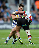 Tom Dunn of Bath Rugby is tackled by Maurie Fa'asavalu of Harlequins during the Aviva Premiership match between Harlequins and Bath Rugby at The Twickenham Stoop on Saturday 10th May 2014 (Photo by Rob Munro)
