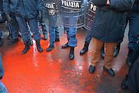 - demonstration for safety at work after the death of seven workers in a fire inside the steel factory Thyssen in Turin; launch of red paint in front of Industrial Association headquarters..- manifestazione per la sicurezza sul lavoro dopo la morte di sette operai in un incendio all'interno delle acciaierie Thyssen di Torino; lancio di vernice rossa davanti alla sede della Associazione Industriali