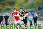 Dan O'Donoghue East Kerry in hot pursuit of David Mannix  Austin Stacks  during their SFCC clash in Lewis Road on Saturday