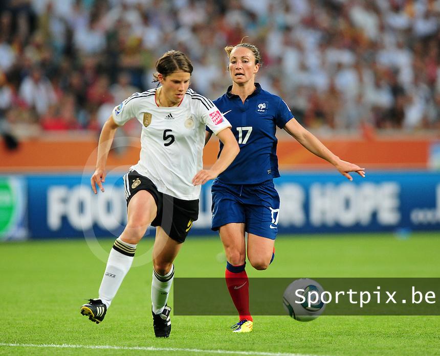 Fifa Women's World Cup Germany 2011 : France - Germany ( Frankrijk - Duitsland ) at Munchengladbach World Cup stadium : Annike KRAHN aan de bal voor Gaetane THINEY.foto DAVID CATRY / Vrouwenteam.be
