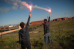 Two boys with bengal lights close to CAceres penitentiary center. CAceres (Spain).  February 20, 2016. Some friends and relatives of Basque political prisoners take part on a march to Caceres penitentiary center, within the campaign of 40 marches to 40 prisons where Basque prisoners are imprisoned. These marches are to denounce the dispersal policy those prisoners suffer since more than 25 years. (Gari Garaialde / Bostok Photo)
