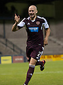 Hearts' Jamie Hamill winds up the Raith fans after scoring his penalty.