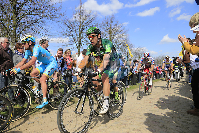 The peloton tackle Sector 10 Mons-en-Pevele during the 113th edition of the Paris-Roubaix 2015 cycle race held over the cobbled roads of Northern France. 12th April 2015.<br /> Photo: Eoin Clarke www.newsfile.ie