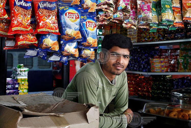 Rajesh runs a snack food stall at Hyderabad railway station, selling among other things Lay's crisps.