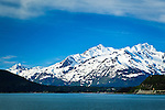 Snow capped Chilkat Mountains over Haines, SE Alaska on a sunny day, early summer.