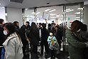March 17, 2011, Osaka, Japan - An immigration officer guides foreign residents of Japan who are faced with long lines and at least a four hour wait for visa and re-entry permit renewal. (Photo by Daiju Kitamura/AFLO).