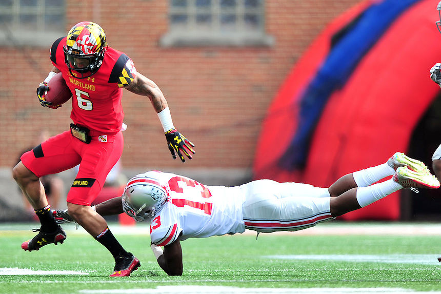 WR Deon Long of the Terrapins tries to elude a tacker. Ohio State trounced Maryland 52-24 during a game at the Capital One Field in Byrd Stadium, College Park, MD on Saturday, October 4, 2014.  Alan P. Santos/DC Sports Box