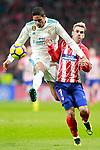 Atletico de Madrid's Antoine Griezmann (r) and Real Madrid CF's Raphael Varane during La Liga match. November 18,2017. (ALTERPHOTOS/Acero)