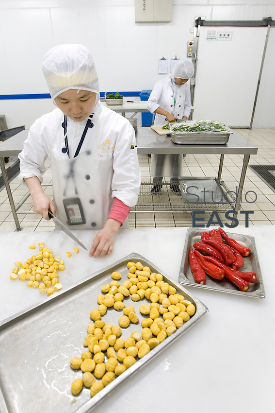 GUANGZHOU, CHINA - April 07: An employee prepares chestnuts and peppers in Guangzhou Nanland Air Catering Co. Ltd. center (Servair) on April 7, 2009 in Guangzhou, China. (Photo by Lucas Schifres/ Getty Images)