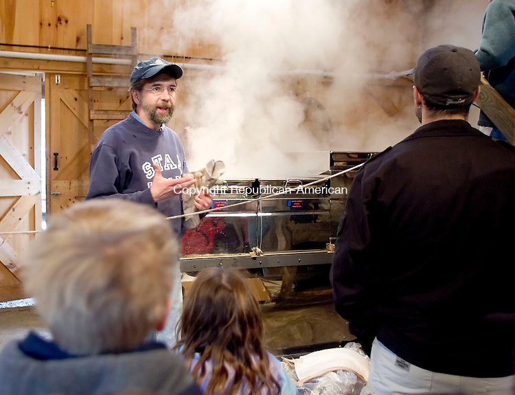 WOODBURY, CT- 16 MARCH 2008- 031608JT07-<br /> Harry Gerowe explains the process of turning sap into maple syrup at Flanders Nature Center in Woodbury on Sunday during the Family Fun egg hunt. In the background is boiling sap.<br /> Josalee Thrift / Republican-American