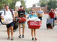 NWA Democrat-Gazette/DAVID GOTTSCHALK   Jacom Kuehn (from left), an incoming freshman at the University of Arkansas, is helped by volunteers Trent Willson (cq) and Brittany Watts Monday, August 17, 2015 as he moves into the dorms on campus in Fayetteville. Monday was the move in day for Freshman students and volunteer assistance was made available.