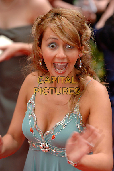 SAMIA SMITH.Arrivals at the British Academy Television Awards, (BAFTA's) held at Grosvenor House Hotel, London, .England, May 7th 2006..bafta baftas half length funny face mouth eyes hand ghadie.Ref: PL.www.capitalpictures.com.sales@capitalpictures.com.©Phil Loftus/Capital Pictures