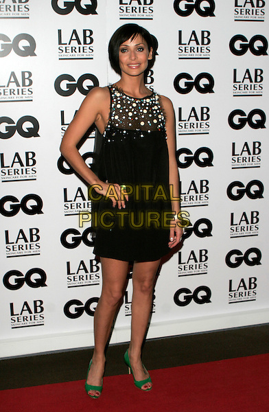 NATALIE IMBRUGLIA.Attending the 10th Anniversary GQ Men Of The Year Awards, Royal Opera House, Covent Garden, London, England. .full length black dress hand on hip green shoes tattoo ring sheer beads beaded .CAP/AH.©Adam Houghton/Capital Pictures