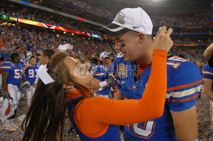 Jan 8, 2007; Glendale, AZ, USA; Florida Gators quarterback (16) Butch Rowley hugs a cheerleader after defeating Ohio State during the BCS National Championship game at the University of Phoenix Stadium. Florida defeated Ohio State 41-14. Mandatory Credit: Mark J. Rebilas