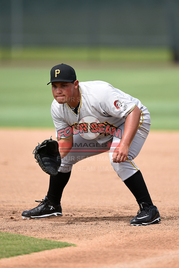 GCL Pirates first baseman Carlos Munoz (23) during practice before a game against the GCL Phillies on June 26, 2014 at the Carpenter Complex in Clearwater, Florida.  GCL Phillies defeated the GCL Pirates 6-2.  (Mike Janes/Four Seam Images)
