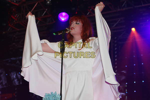 FLORENCE WELCH of FLORENCE AND THE MACHINE.Performs live during Radio One's Big Weekend, Bangor, North Wales, .UK, May 22nd 2010..1 1's music live on stage concert gig half length white cream long dress microphone  singing hands arms raised up train cape holding .CAP/MAR.© Martin Harris/Capital Pictures.