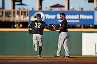Jupiter Hammerheads outfielder Victor Victor Mesa (32) hands Isael Soto (15) his glove and hat during a Florida State League game against the Bradenton Marauders on April 20, 2019 at LECOM Park in Bradenton, Florida.  Bradenton defeated Jupiter 3-2.  (Mike Janes/Four Seam Images)