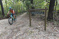 NWA Democrat-Gazette/FLIP PUTTHOFF<br />At a trail junction, riders can choose the Bashore Loop or      Sept. 1 2017     the Dutton Hollow Loop. Bashore Loop is easiest and recommended for beginngers. Dutton Hollow Loop is more difficult, with steeper climbs.