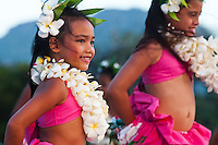Two young girls performing hula at the 2011 Kauai Polynesian Festival