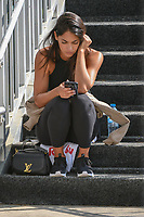 Rickie Fowler's (USA) girlfriend, Allison Stokke checks her social media on the steps to the bridge during the preview of the World Golf Championships, Mexico, Club De Golf Chapultepec, Mexico City, Mexico. 2/28/2018.<br /> Picture: Golffile | Ken Murray<br /> <br /> <br /> All photo usage must carry mandatory copyright credit (&copy; Golffile | Ken Murray)
