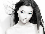Beauty portrait of a cute young Japanese woman anime face with big blue eyes and flying hair. Black and white with blue color.