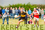 fionn Fitzgerald Dr Crokes goes past Pol O Dubhain Dingles in the club championship final in Milltown on Sunday