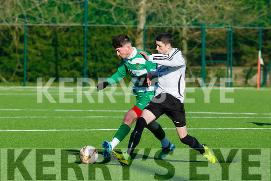Tommy Sheehan Castleisland AFC and Paudie Quinn Listowel Celtic contesting for the ball during their Premier league gane in Georgie O'Callaghan Park on Sunday
