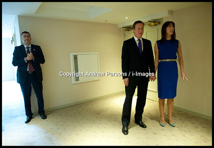 British Prime Minister David Cameron with his wife Samantha Cameron before delivering his speech to delegates on the last day of the Conservative party conference, International Convention Centre, October 10, 2012, Birmingham, England. Photo by Andrew Parsons / i-Images..