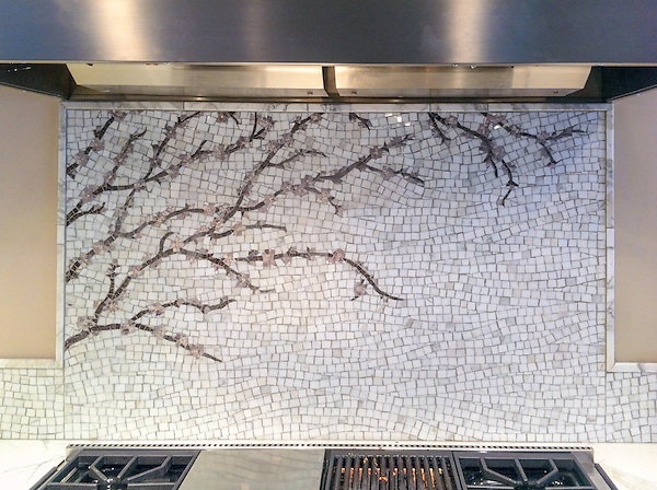 Plum Blossom, a natural stone hand cut mosaic, is shown in Calacatta Tia, Saint Laurent, Lavender Mist and Desert Pink.