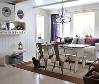 View of the dining area from the kitchen, furnished with old family heirlooms, such as the wall cabinet and bench