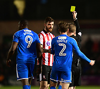Lincoln City's Luke Waterfall is shown a yellow card by referee Ross Joyce<br /> <br /> Photographer Chris Vaughan/CameraSport<br /> <br /> The EFL Sky Bet League Two - Lincoln City v Notts County - Saturday 13th January 2018 - Sincil Bank - Lincoln<br /> <br /> World Copyright &copy; 2018 CameraSport. All rights reserved. 43 Linden Ave. Countesthorpe. Leicester. England. LE8 5PG - Tel: +44 (0) 116 277 4147 - admin@camerasport.com - www.camerasport.com