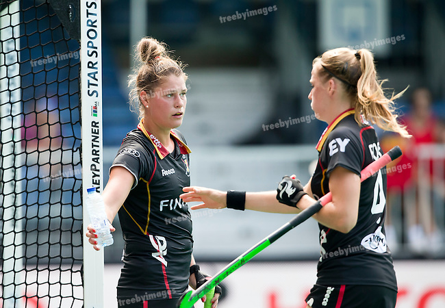 02/07/2015<br /> HWL Semi Final Antwerp Belgium 2015<br /> Japan v Belgium Women<br /> Stephanie de Groof offers a drink in the hot conditions to Aline Fobe<br /> Photo: Grant Treeby
