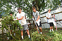 Tulane freshmen Jonathan Star, Matt Schroeder, Chase Schupp and Sam Wetzel clean up a backyard while volunteering with South Seventh Ward Neighbors, 2016.