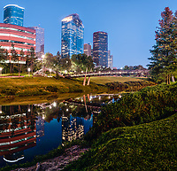 This is a vertical panorama of the Sabine to Bagby promenade over the Buffalo Bayou with the Houston Skyline at the blue hour.  You can see the Wells Fargo building towering as the second tallest building in the city along with the impressive Heritage Plaza as the fifth tallest in the city.  We capture a pano image so we could capture the Houston skyline and bridge along with their reflections in the waters of the Buffalo Bayou in downtown Houston.