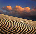 Sand Ripples And A Stormy Cloudscape At Evening Time, Death Valley National Park, California