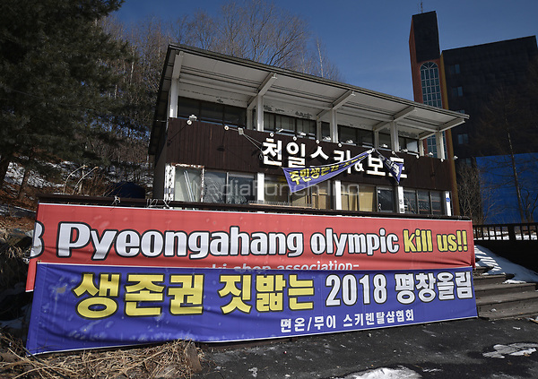 A protest sign against the Winter Games hanging from an abandoned ski rental in the Olympic Snowboard Phoenix Snow Park in Pyeongchang, South Korea, 07 February 2018. The Pyeongchang 2018 Winter Olympics take place between 09 and 25 February. Photo: Angelika Warmuth/dpa /MediaPunch ***FOR USA ONLY***