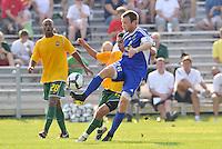 Ely Allen (blue ,minn), Gauchinho (stl)...AC St Louis and NSC Minnesota Stars played to a 2-2 tie at Anheuser-Busch Soccer Park, Fenton, Missouri.