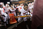 Wisconsin Badgers defensive lineman Chikwe Obasih (34) celebrates with the Paul Bunyan Axe after an NCAA College Big Ten Conference football game against the Minnesota Golden Gophers Saturday, November 25, 2017, in Minneapolis, Minnesota. The Badgers won 31-0. (Photo by David Stluka)