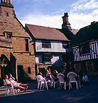 A3AAG7 People sitting in a courtyard outside a pub Sherborne Dorset England