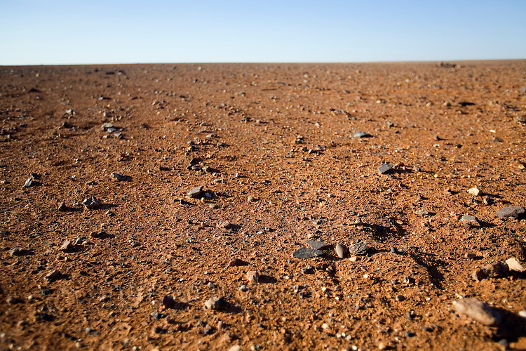 The lunar like desert landscape of the Moon Plain, near Coober Pedy.  The surreal plain has been the setting for many movies including Mad Max Beyond the Thunderdome, Priscilla Queen of the Desert, and The Red Planet.  Coober Pedy, South Australia, AUSTRALIA.
