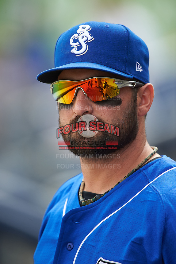 Biloxi Shuckers catcher Tyler LaTorre (22) in the dugout during the first game of a double header against the Pensacola Blue Wahoos on April 26, 2015 at Pensacola Bayfront Stadium in Pensacola, Florida.  Biloxi defeated Pensacola 2-1.  (Mike Janes/Four Seam Images)