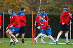 Rangers players warming up before a high-tempo session on the pitch