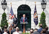 United States President Donald J. Trump, right, makes remarks as he hosts Martin Truex Jr., the NASCAR Cup Series champion, center, and his team, on the South Lawn of the White House in Washington, DC on Monday, May 21, 2018.  Truex competes full-time in the Monster Energy NASCAR Cup Series for Furniture Row Racing.  Pictured at left is Sherry Pollex is the longtime girlfriend of Truex Jr. who has been battling ovarian cancer since 2014.<br /> Credit: Ron Sachs / CNP