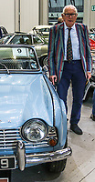 BNPS.co.uk (01202 558833)<br /> Pic:SusanScofield/BNPS<br /> <br /> Derrick Schofield with the Triumph <br /> <br /> A pensioner who has sold beloved classic car due to his failing eyesight is spending the proceeds on laser treatment to restore his vision so he can drive again.<br /> <br /> Derrick Schofield bought the Triumph TR4 brand new in 1962 because it could fit his large baritone saxophone in the boot.<br /> <br /> The musician and self-confessed ladies' man said the convertible motor used to impress the girls so much that he nicknamed it the 'Crumpet Catcher'.<br /> <br /> After six decades of happy motoring in it the 87-year-old has had to sell his pride and joy as he can no longer drive due to his poor eyesight.<br /> <br /> The Triumph went under the hammer for £16,000 and Derrick said he will use the money on medial treatment to see again.