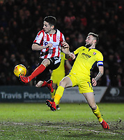 Lincoln City's Tom Pett vies for possession with Cheltenham Town's Carl Winchester<br /> <br /> Photographer Andrew Vaughan/CameraSport<br /> <br /> The EFL Sky Bet League Two - Lincoln City v Cheltenham Town - Tuesday 13th February 2018 - Sincil Bank - Lincoln<br /> <br /> World Copyright &copy; 2018 CameraSport. All rights reserved. 43 Linden Ave. Countesthorpe. Leicester. England. LE8 5PG - Tel: +44 (0) 116 277 4147 - admin@camerasport.com - www.camerasport.com